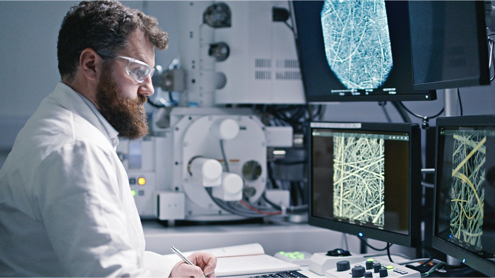 A scientist studying fibers on computer screens